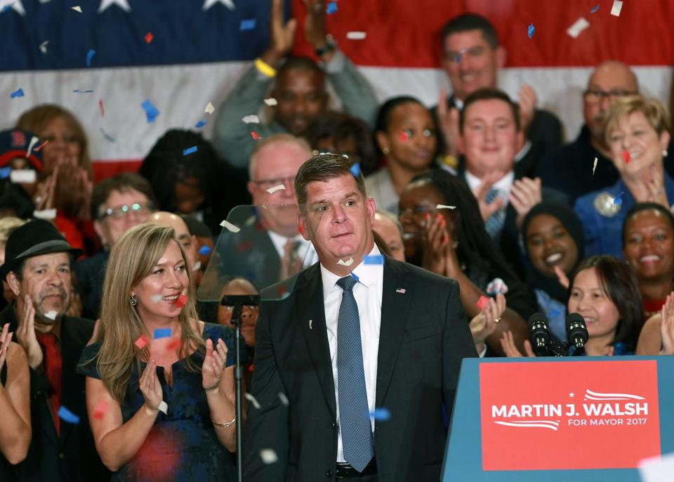Boston, MA: 11-7-17: Boston Mayor Martin Walsh celebrated his re-election to a second term at a party held in the Grand Ballroom of the Fairmont Copley Plaza Hotel. He is pictured with his girlfriend Lorrie Higgins as the confetti starts to fall folowing his speech. (Jim Davis/Globe Staff)