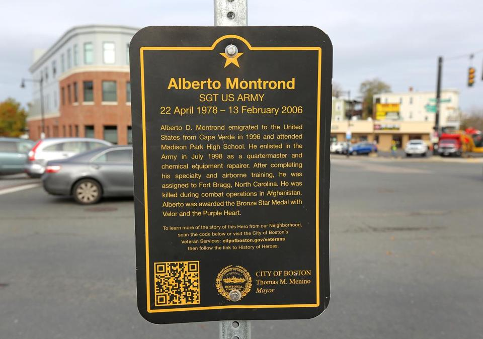 The plaque honoring Army Sergeant Alberto Montrond tells visitors to his hero square about his biographical information.