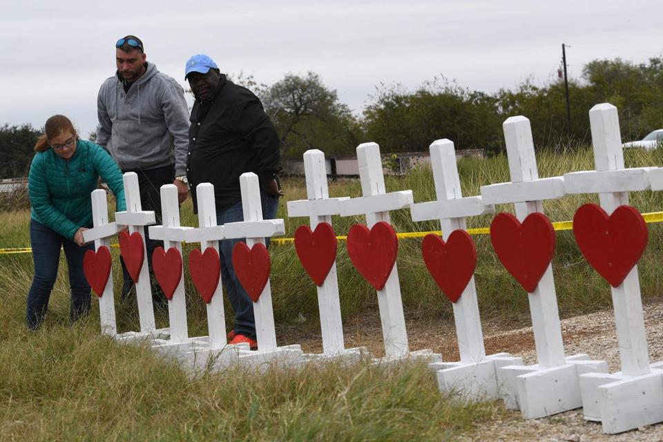 People unload crosses outside the First Baptist Church which was the scene of the mass shooting that killed 26 people in Sutherland Springs, Texas on November 8, 2017. A gunman wearing all black armed with an assault rifle opened fire on a small-town Texas church during Sunday morning services, on November 5, killing 26 people and wounding 20 more in the last mass shooting to shock the United States. / AFP PHOTO / MARK RALSTONMARK RALSTON/AFP/Getty Images