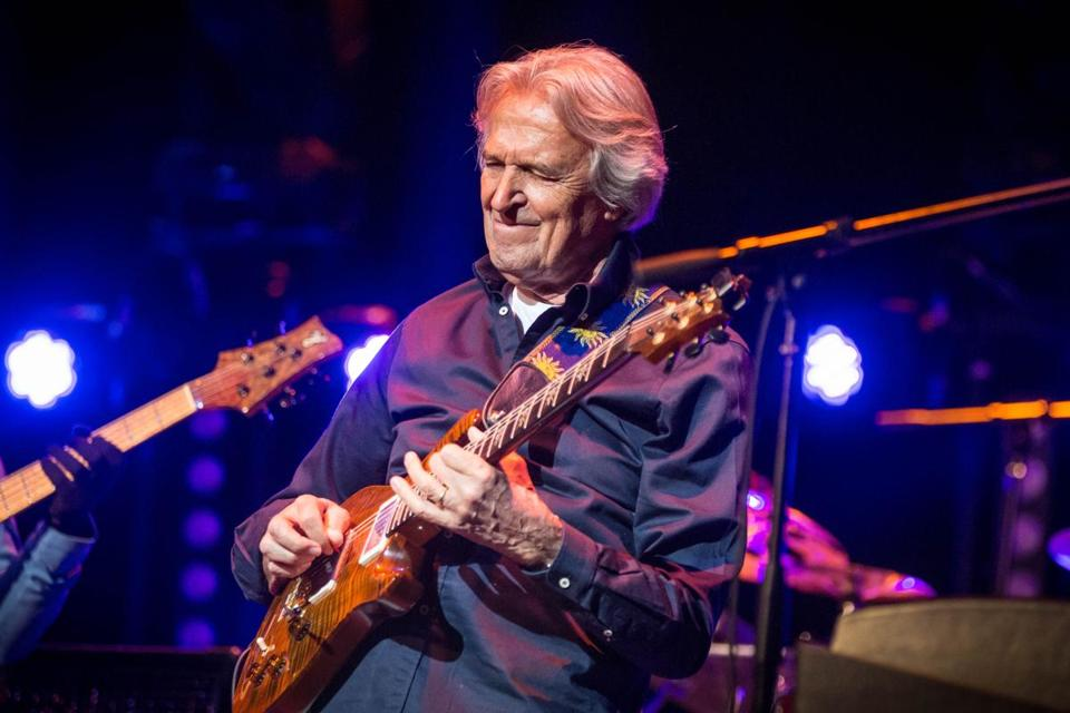 Guitarist John McLaughlin performing onstage with his band the 4th Dimension at the Wilbur Theatre Wednesday night .