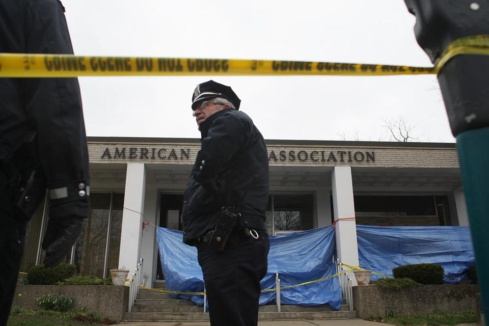 A police officer stood in front of the marked-off crime scene.