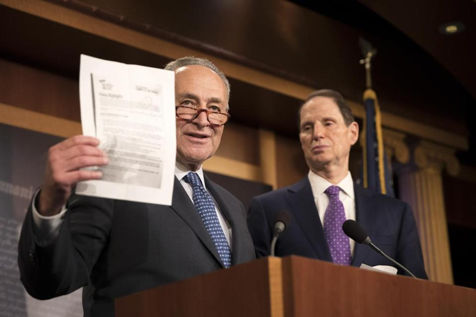Senate Minority Leader Chuck Schumer, left, with Senator Ron Wyden, an Oregon Democrat, spokw about the Republican tax plan on Nov. 9.