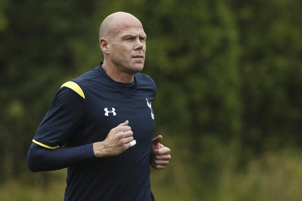 FILE - In this July 17, 2014, file photo, Brad Friedel warms up during Tottenham Hotspurs practice at Virgina Mason Athletic Center in Renton, Wash. Former U.S. national team goalkeeper Brad Friedel is the new head coach of the New England Revolution. The appointment was announced on Thursday, Nov. 9, 2017. (AP Photo/The Seattle Times, Madeleine Meyer, File)