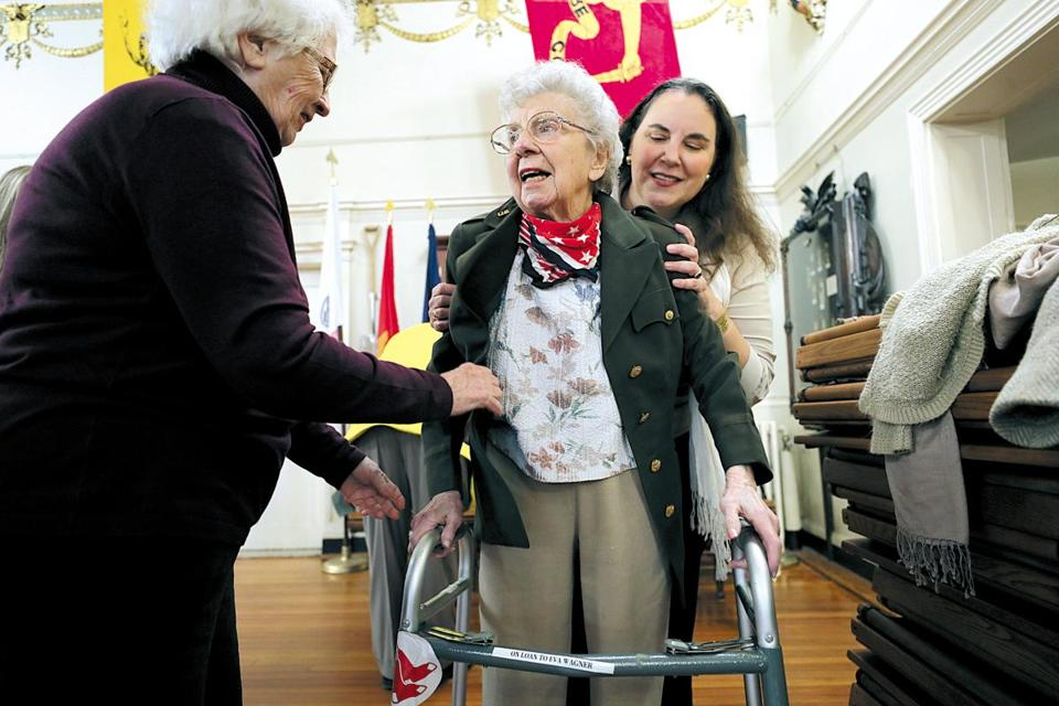 Boston, Ma., 11/10/17, One hundred-three-three-year old Eva Wagner, WW2 veteran, First Lieutenant with the US Army Nurse Corps, gets help from her family getting into her actual uniform from WW2. She was one of the speakers at the town hall meeting. On the left is her niece Gloria Webster, on right is great neice Kira Jacobs. Boston Veteran Services and Brighton Marine held a Special Veterans Day Town Hall at the Ancient and Honorable Artillery Museum in Faneuil Hall. It is part of a National Veterans Town Hall Initiative conceived by Congressman Seth Moulton, a veteran himself, and author Sebastian Junger, who has written about the importance of veterans sharing their experiences with their communities. It is a community forum aiming to establish a greater understanding between local veterans and the friends and neighbors they fought for. Globe staff/Suzanne Kreiter