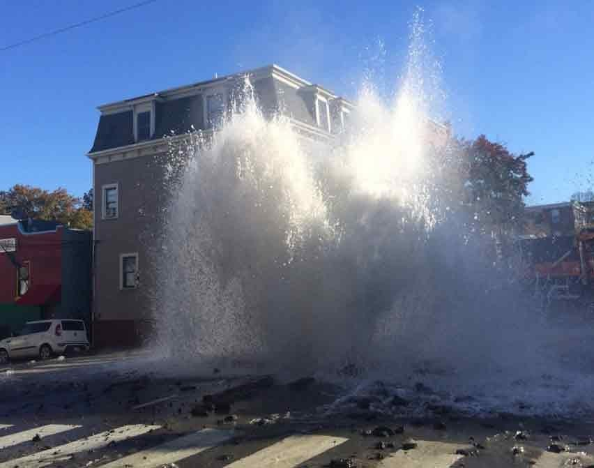 Water gushed into the air after a water main break at Cambridge Street and 5th Street in Cambridge on Saturday morning.