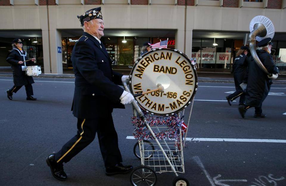 Mario Taricano played the drum while marching with the Waltham American Legion Band during the Veterans Day Parade in Boston on Saturday.