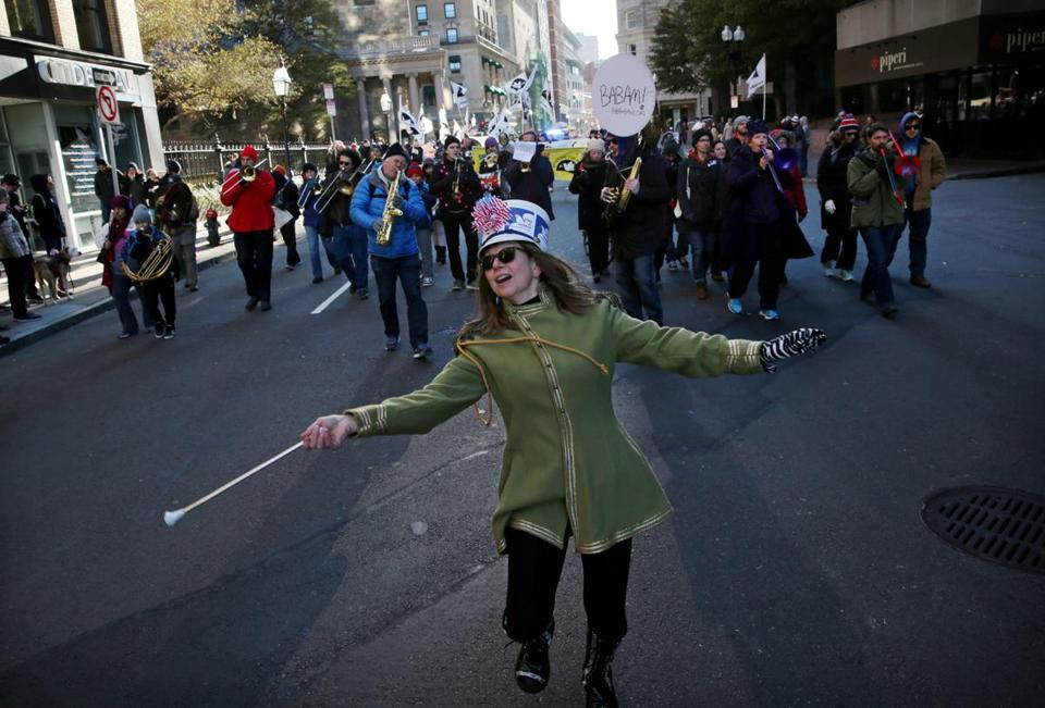 Majorette Joanne Piazzi of the Leftist Marching Band led the Boston Area Brigade of Activist Musicians during the Veterans for Peace Armistice Day Parade in Boston on Saturday.