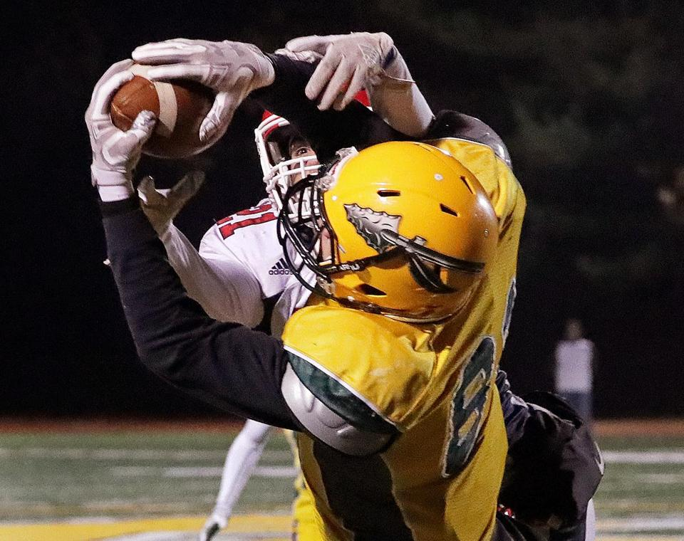 Wrentham, MA - 11/10/2017 - King Philip wide receiver (81) makes the reception for a long catch for first down on the B-R 17 yard line over B-R defensive back Nico Carucci (21) that set up the go ahead touchdown that put the Warriors up for good early in the third quarter. King Philip football hosts Bridgewater-Raynham in the Division 2 South final. - (Barry Chin/Globe Staff), Section: Sports, Reporter: Nathaniel Weitzer, Topic: 11schkingphilip, LOID: 8.4.12170739.