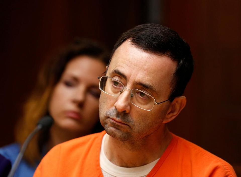 "(FILES) This file photo taken on June 23, 2017 shows former Michigan State University and USA Gymnastics doctor Larry Nassar seen in the 55th District Court where Judge Donald Allen Jr. bound him over in Mason, Michigan, to stand trial on 12 counts of first-degree criminal sexual conduct. Olympic gold medal-winning US gymnast Aly Raisman has revealed that she was sexually abused by former USA Gymnastics team doctor Larry Nassar. Raisman, 23, is the latest member of the US national team and the biggest US gymnastics star to reveal being molested by Nassar, who is facing more than 20 counts of sexual assault. Raisman revealed the sexual abuse by Nassar in a preview on November 10, 2017 of an interview to be aired in full on Sunday on the CBS show ""60 Minutes."" / AFP PHOTO / JEFF KOWALSKYJEFF KOWALSKY/AFP/Getty Images"