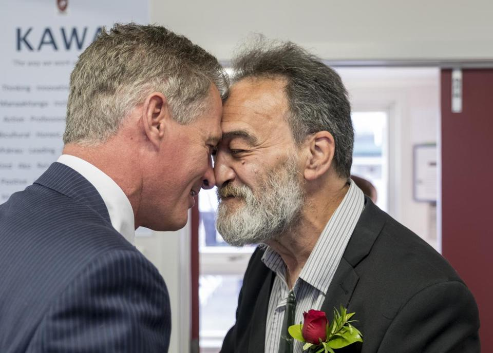 U.S. Ambassador to New Zealand and Samoa Scott Brown shares a hongi with Māori elder Mike Paki before the Rangitikei College awards ceremony on Nov. 7, 2017. A hongi is a traditional Māori greeting. Ambassador Brown has been taking Māori language classes and introduced himself at the ceremony with a mihimihi, a Māori introduction at a gathering. (Jeremy Lurgio)