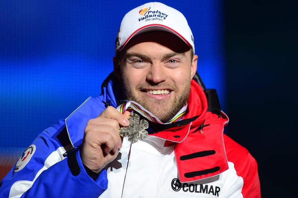 France's David Poisson holding his bronze medal during the medal ceremony after the men's downhill event of the 2013 Ski World Championships in Schladming, Austria.
