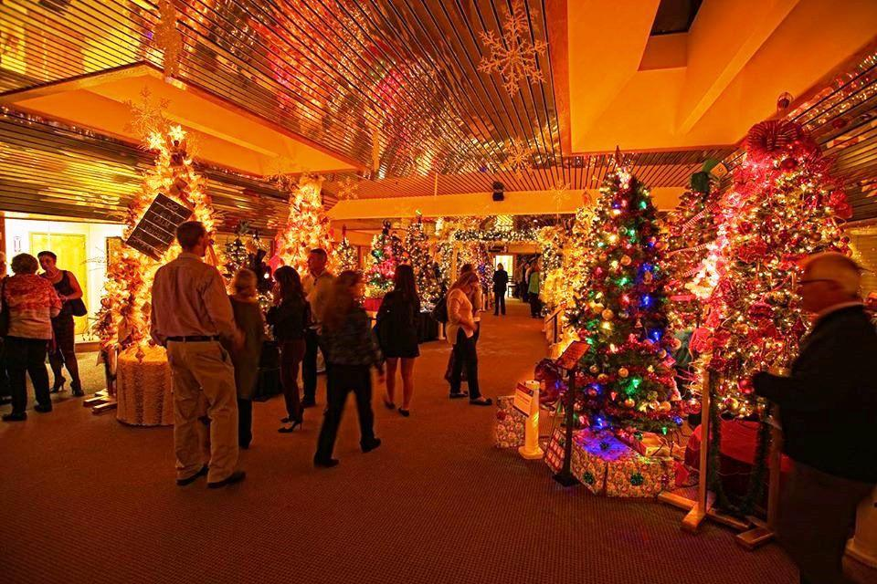 Visitors view the display at the 2016 Methuen Festival of Trees. (handout) - A Festival Of Trees, A Retro Billboard, And A Fishy Documentary