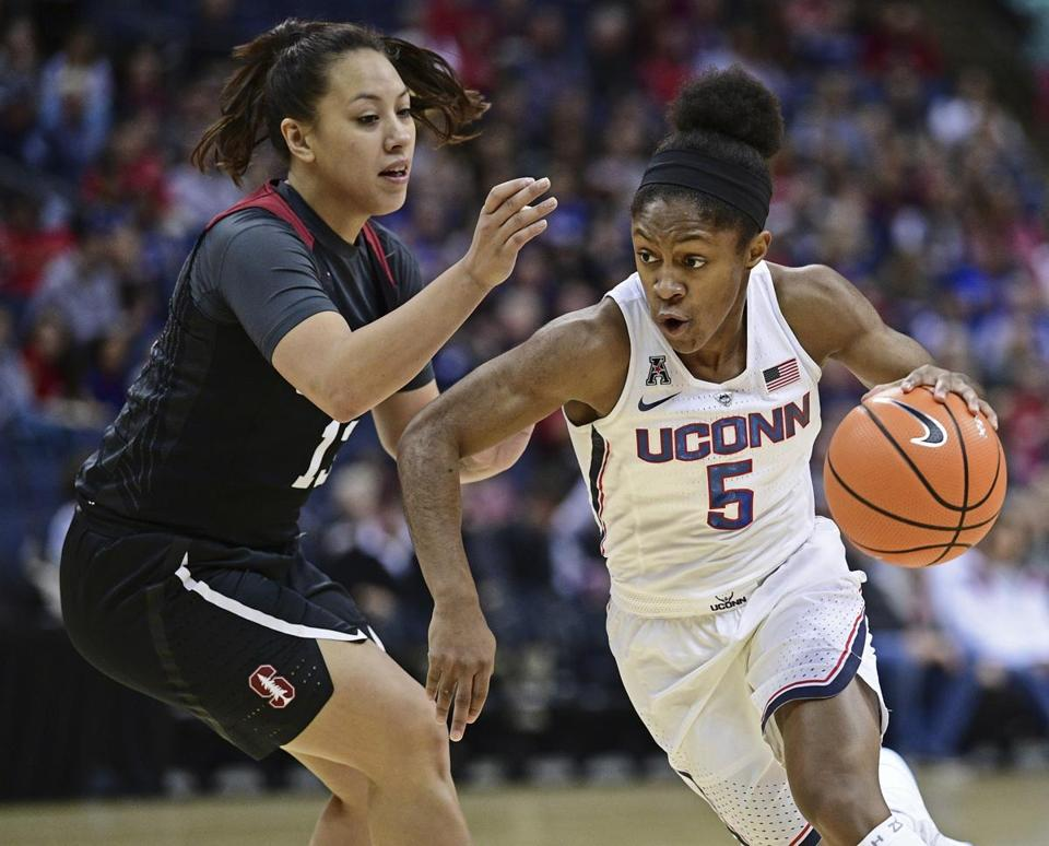 UConn's Crystal Dangerfield drives on Stanford's Marta Sniezek during the first quarter Sunday.