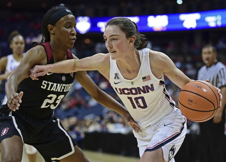 UConn's Molly Bent drives on Stanford's Kiana Williams in the fourth quarter Sunday.
