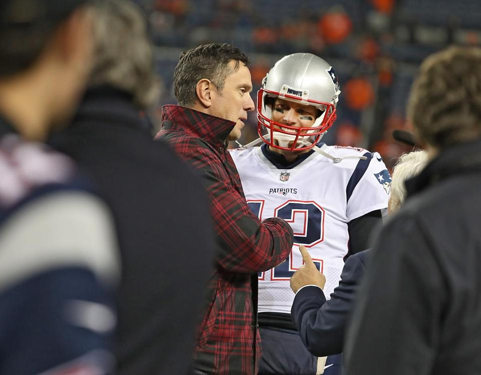 Drew Bledsoe (left) talks to Brady before the game.