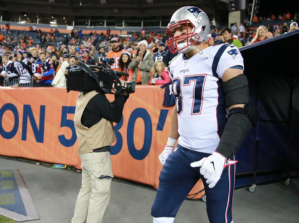 Rob Gronkowski runs onto the field prior to kickoff.