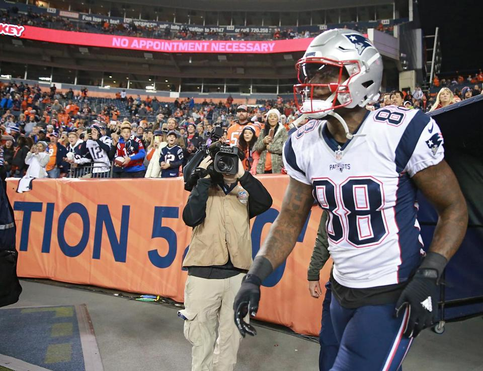Bennett running onto the field in Denver prior to kickoff.