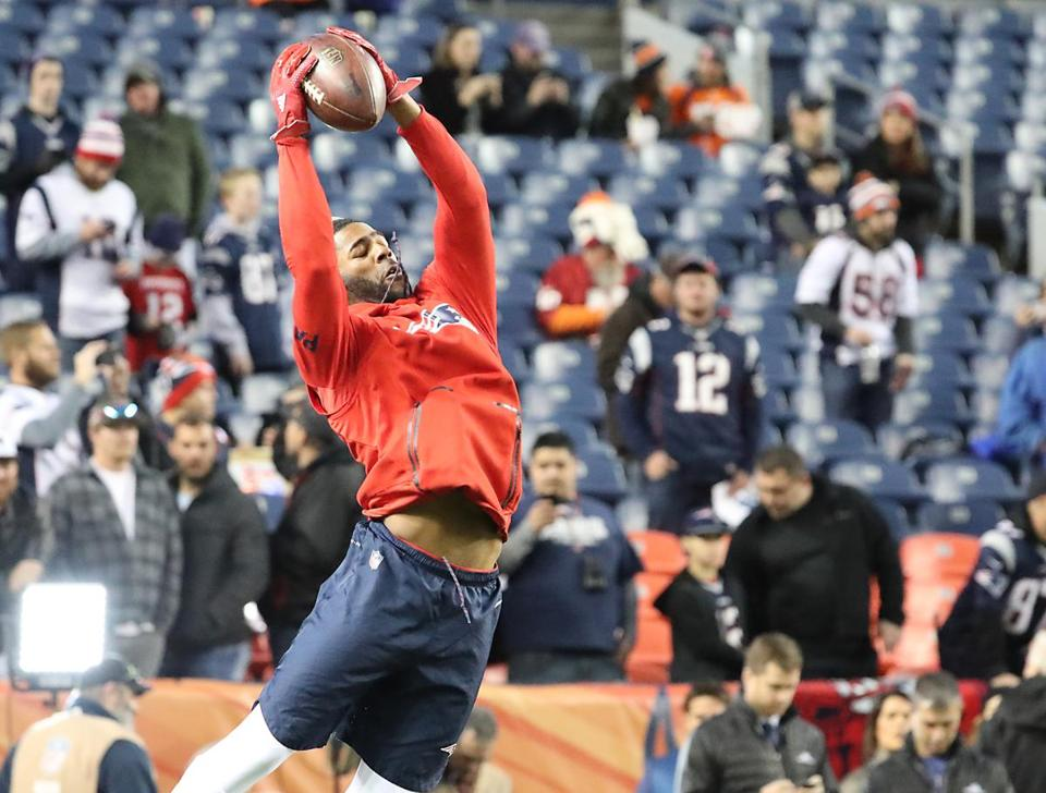 Cornerback Malcolm Butler makes a catch as he warms up.