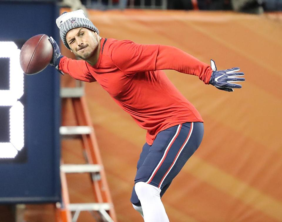 Receiver Danny Amendola tosses a ball during warmups.