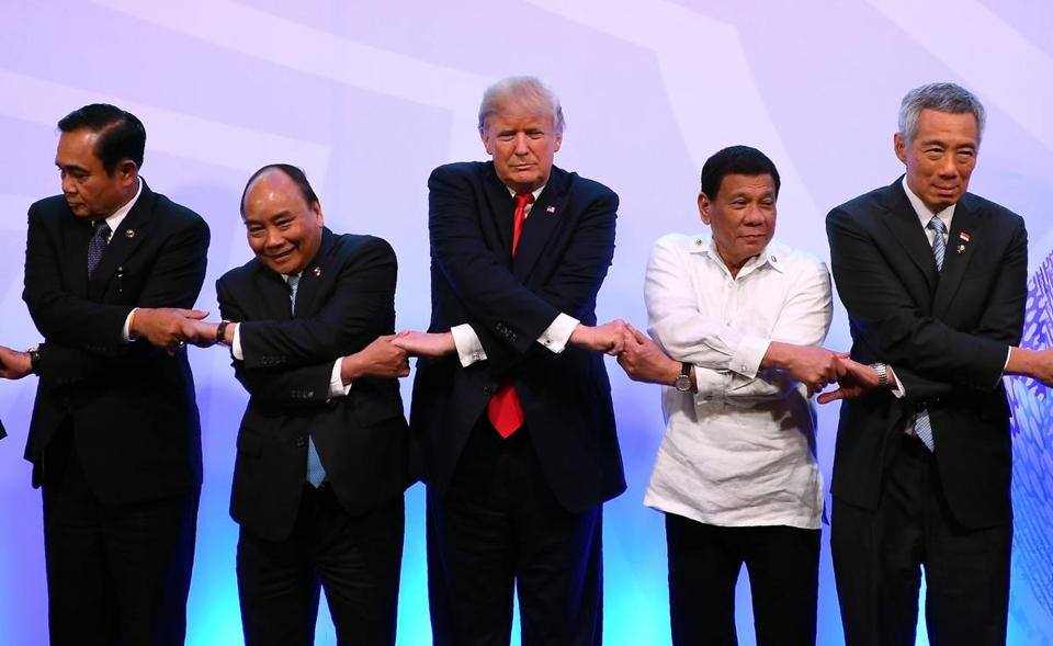 Leaders from left to right, Thailand's Prime Minister Prayuth Chan-ocha, Vietnam's Prime Minister Nguyen Xuan Phuc, U.S. President Donald Trump, Philippine President Rodrigo Duterte and Singapore's Prime Minister Lee Hsien Loong pose for a family photo during the ASEAN-U.S. Summit in Manila, Philippines on Monday Nov. 13, 2017. (Manan Vatsyayana/Pool Photo via AP)