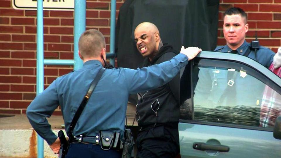 James Morales was escorted into the Mass. State Police barracks in Medford in January.