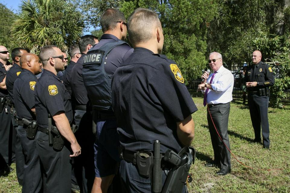 Mayor Bob Buckhorn addressed members of the Tampa Police Department during a roll call at Giddens Park in the Seminole Heights neighborhood in Tampa, Fla.