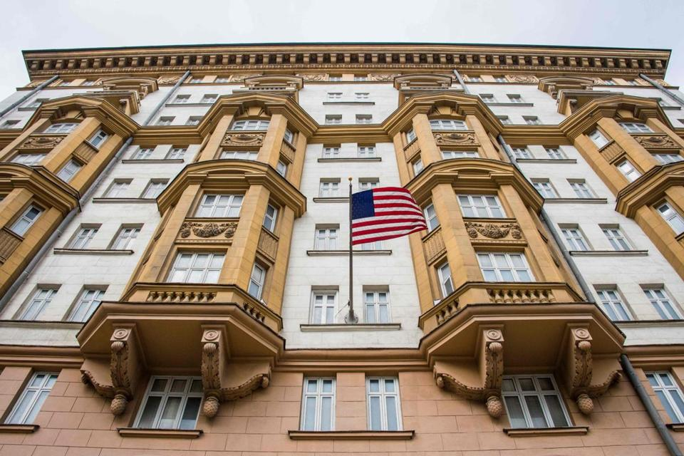 "(FILES) This file photo taken on July 31, 2017 shows the US embassy building in Moscow. Washington will halt the issuance of all non-immigrant visas in Russia for nine days from August 23, 2017 and will thereafter reduce visa operations, the US embassy in Moscow said Monday, citing the ""Russian government-imposed cap"" on its staff levels. / AFP PHOTO / Mladen ANTONOVMLADEN ANTONOV/AFP/Getty Images"