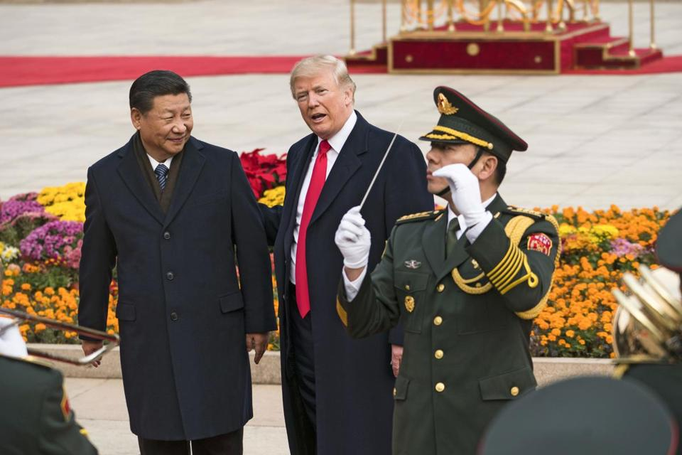 FILE -- President Donald Trump with President Xi Jinping of China during a welcome ceremony in Beijing, Nov. 9, 2017. Trump has confirmed that he appealed to President Xi Jinping of China on behalf of three basketball players from the University of California, Los Angeles, who were arrested last week in Hangzhou, China, on suspicion of shoplifting. (Doug Mills/The New York Times)