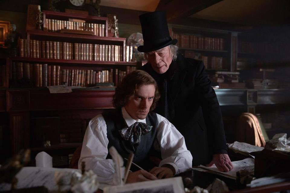 "Dan Stevens (left, as Charles Dickens) and Christopher Plummer (right, as Ebenezer Scrooge) in ""The Man Who Invented Christmas."""