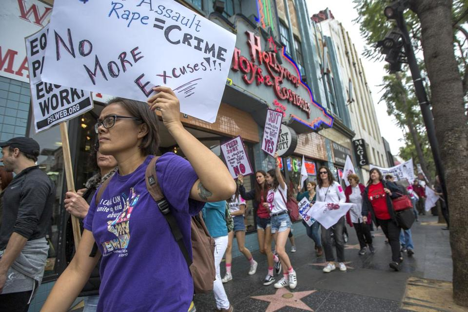 Demonstrators participated in the #MeToo Survivors' March on Sunday in response to the recent high-profile sexual abuse cases.