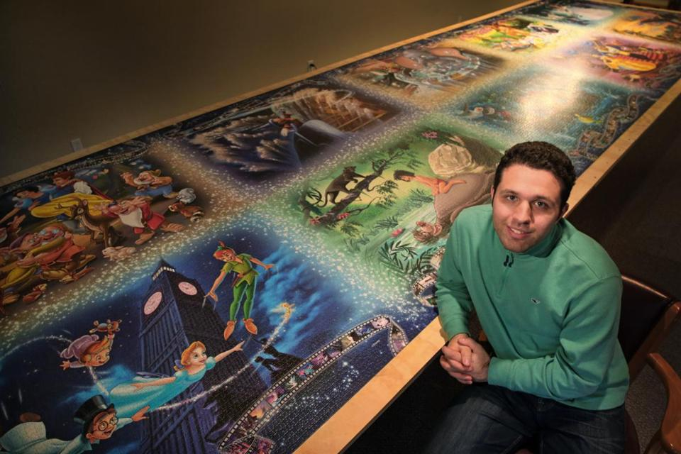 Brait, with the completed 22½-foot-long puzzle of Disney animated movies.