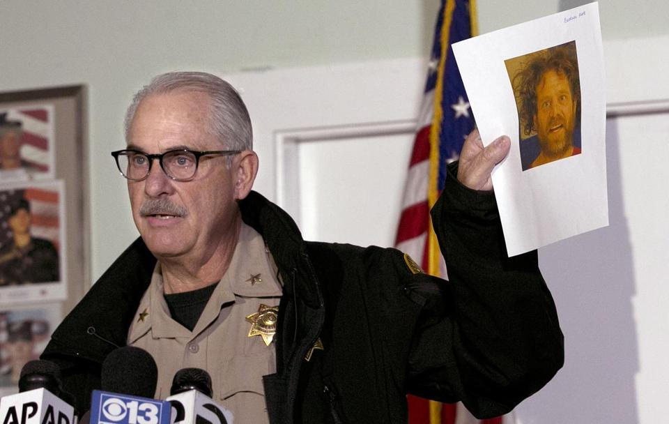 Phil Johnston, the assistant sheriff for Tehama County, displayed a booking photo, from a prior arrest, of Kevin Janson Neal, during a news conference on Wednesday.