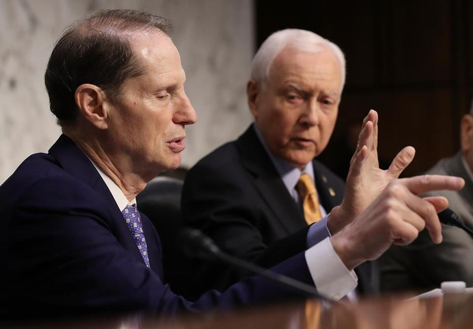 WASHINGTON, DC - NOVEMBER 15: Senate Finance Committee chairman Orrin Hatch (R-UT) (R) interrupts ranking member Sen. Ron Wyden (D-OR) during a markup by the committee of the Republican tax reform proposal on November 15, 2017 in Washington, DC. Republicans announced their intention to include a repeal of the Affordable Care Act's individual madate. (Photo by Win McNamee/Getty Images)
