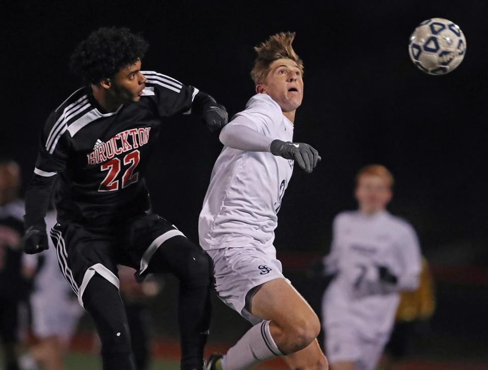 Brockton, MA: 11-14-17: Brocktons Moacyr Ramos (left) and St. John's Steven Yakita (right) battle in first half action. St. John's Prep took on Brockton in the Division One Boy's State Soccer Semi-Finals at Brockton High School. (Jim Davis/Globe Staff)