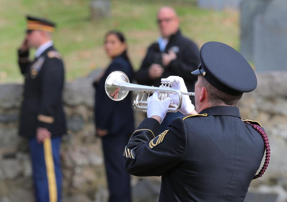 A solider played Taps after Thomas Hudner's funeral Mass.