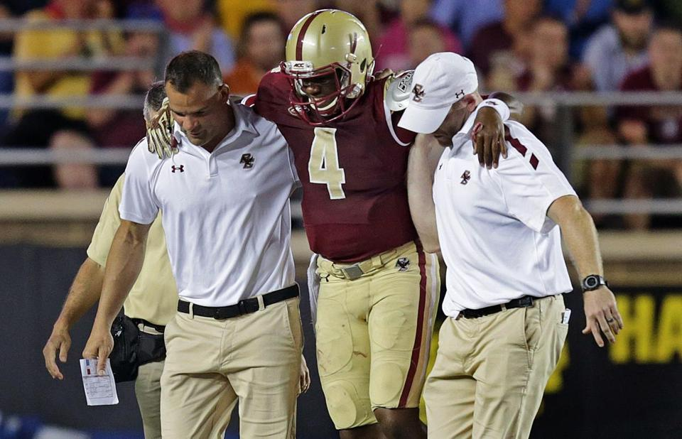 Wade is helped off after being hurt against Florida State in 2015.