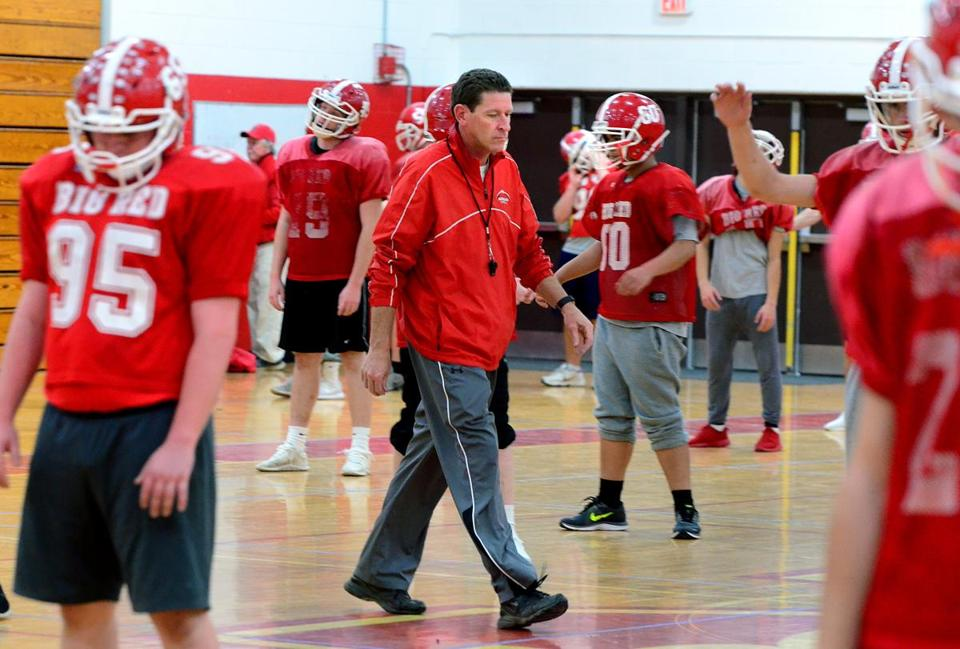 North Attleborough 11/16/2017: North Attleborough High school football head coach Don Johnson walks through his players as they loosen up during practice inside the gym. The team will be playing in the upcoming State semifinal game against Tewksbury. Photo by Debee Tlumacki for the Boston Globe (sports)