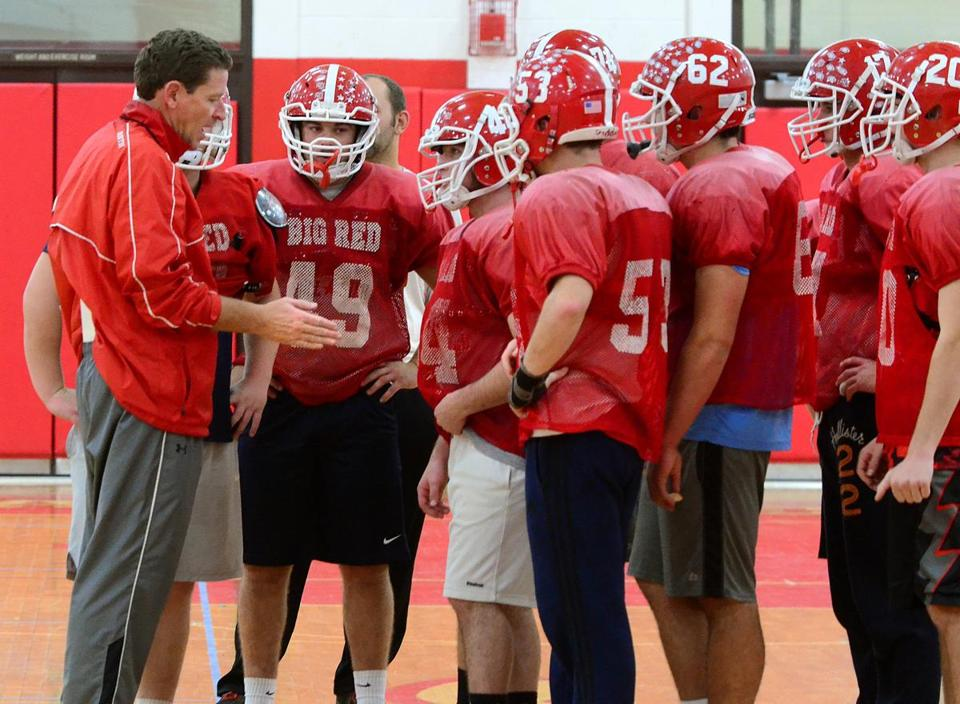 North Attleborough 11/16/2017: North Attleborough High school football head coach Don Johnson coaches the team during practice inside the gym. The team will be playing in the upcoming State semifinal game against Tewksbury. Photo by Debee Tlumacki for the Boston Globe (sports)