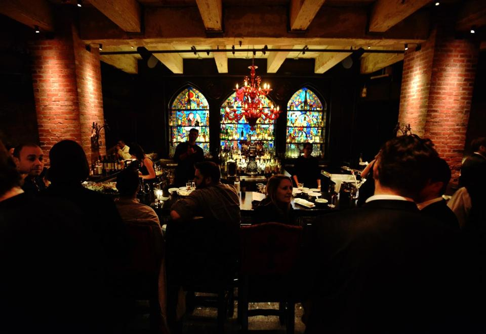 Stained glass windows and red chandeliers dominate the decor at Lolita Cocina & Tequila Bar in Fort Point.