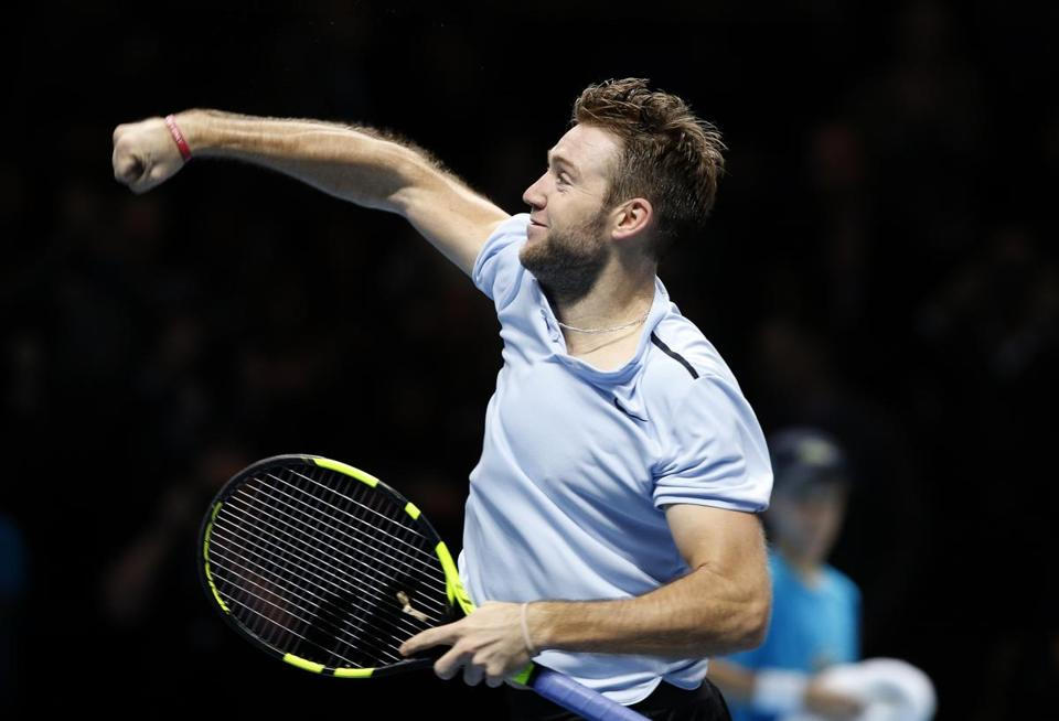 Jack Sock of the United States celebrates after defeating Alexander Zverev of Germany in their men's singles tennis match at the ATP World Finals at the O2 Arena in London, Thursday, Nov. 16, 2017. (AP Photo/Alastair Grant)