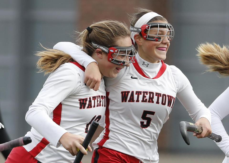 Watertown's Sydney Poulin is congratulated after scoring by teammate Gabriella Venezia (5) during their 5-1 win over Oakmont in the D2 state final in Worcester, Mass., Saturday, Nov. 18, 2017. (Winslow Townson for The Boston Globe)