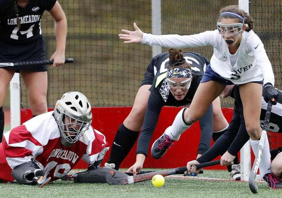 Andover's Hanna Medwar (right) eyed this loose ball in front of Longmeadow goalie Gabrielle Acquitsta and Sydney Harris (center).