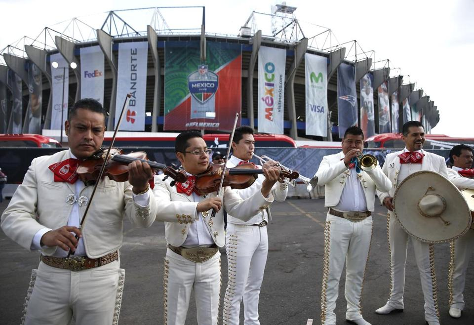 Mexico City, Mexico -- 11/19/2017 - Mariachis play outside of Estadio Azteca before the start of the 2017 NFL Mexico Game between the New England Patriots and Oakland Raiders. (Jessica Rinaldi/Globe Staff) Topic: Patriots Reporter: