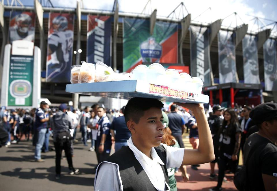 Mexico City, Mexico -- 11/19/2017 - A vendor sells snacks outside of Estadio Azteca before the start of the 2017 NFL Mexico Game between the New England Patriots and Oakland Raiders. (Jessica Rinaldi/Globe Staff) Topic: Patriots Reporter: