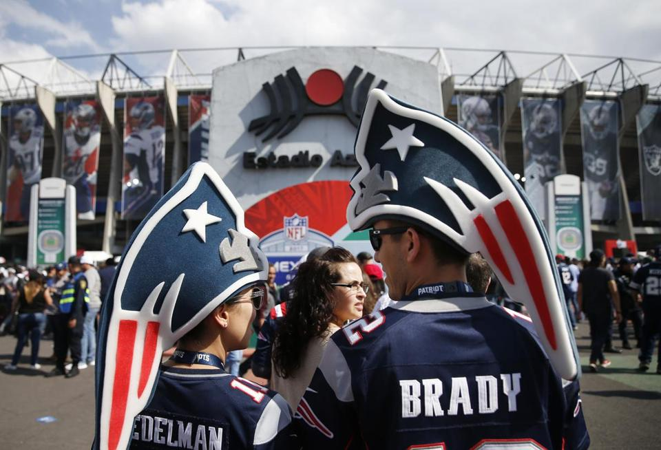 Mexico City, Mexico -- 11/19/2017 - Fans wait in line to pose for a photo outside of Estadio Azteca before the start of the 2017 NFL Mexico Game between the New England Patriots and Oakland Raiders. (Jessica Rinaldi/Globe Staff) Topic: Patriots Reporter: