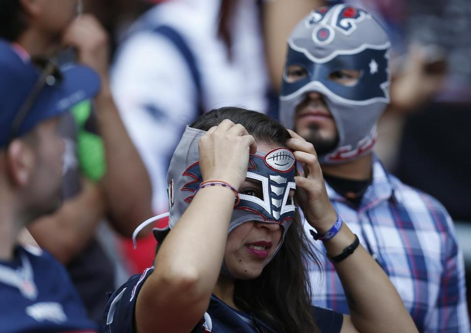 Mexico City, Mexico -- 11/19/2017 - A fan adjusts her Lucha Libre mask before the start of the New England Patriots vs. Oakland Raiders 2017 NFL Mexico Game at the Estadio Azteca. (Jessica Rinaldi/Globe Staff) Topic: Patriots Reporter: