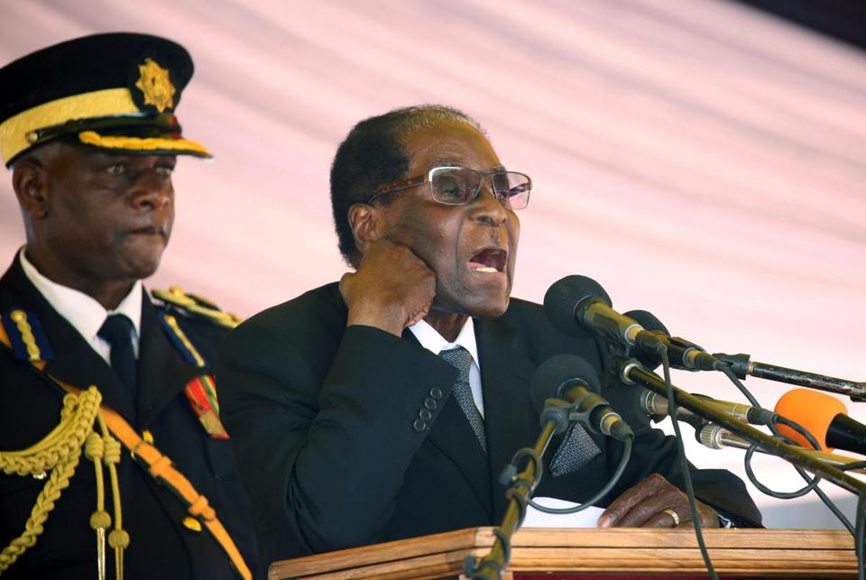 Mandatory Credit: Photo by AARON UFUMELI/EPA-EFE/REX/Shutterstock (9230355a) Robert Mugabe Zimbabwe Robert Mugabe resignation deadline past, Harare - 01 Nov 2017 (FILE) - Zimbabwe President Robert Mugabe (R) delivers a speech during the burial of liberation war hero Don Muvuti at the national heroes acre in Harare, Zimbabwe, 01 November 2017, (reissued 20 November 2017). Media reports that deadline set by the the ruling Zanu-PF party for Robert Mugabe to resign has past on on 20 Nove later in the day to discuss the possible impeachment of President Mugabe.