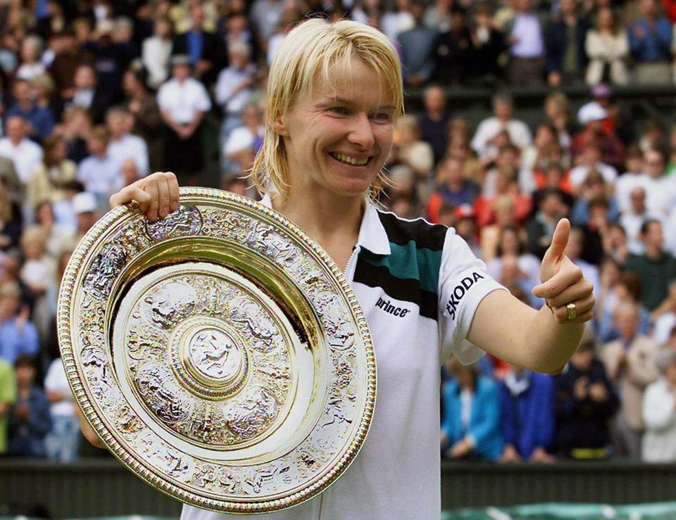Mandatory Credit: Photo by ANJA NIEDRINGHAUS/EPA-EFE/REX/Shutterstock (9230121b) Jana Novotna Reports: Jana Novotna dies of cancer at the age of 49, Wimbledon, United Kingdom - 04 Jul 1998 (FILE) - Jana Novotna of the Czech Republic thumbs up as she shows her trophy after winning the ladies' single final of the Wimbledon Tennis Championships, in Wimbledon, Britain, 04 July 1998 (reissued 20 November 2017). Media reports on 20 November 2017 state that Jana Novotna died at the age of 49. Novotna, who won 16 Grand Slam titles, died of cancer and was surrounded by her family when she peacefully passed away, International Womens Tennis Association (WTA) chief Steve Simon was quoted as saying.