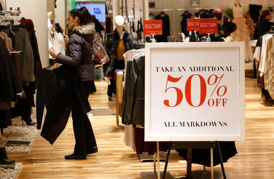 Burlington, MA - 11/25/2016 - A woman looks at sale items at the Burlington Mall in Burlington, MA on November 25, 2016. Many retailers opened the unofficial start of the holiday shopping season known as Black Friday with major sales.(Keith Bedford/Globe Staff) Topic: Reporter: