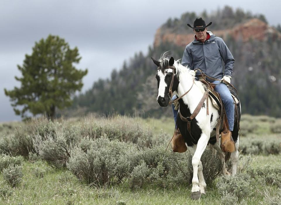 FILE - In this May 9, 2017, file photo, Interior Secretary Ryan Zinke takes a horseback ride in the Bears Ears National Monument with local and state representatives in Blanding, Utah. President Donald Trump is shrinking two national monuments in Utah, Bears Ears and Grand Staircase Escalante, accepting the recommendation of Interior Secretary Ryan Zinke to reverse protections established by two Democratic presidents, a Sen. Orrin Hatch, R-Utah, said Friday, Oct. 27. (Scott G Winterton/The Deseret News via AP)